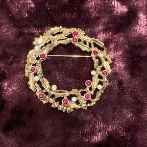 Red and clear rhinestone set in gold tone brooch